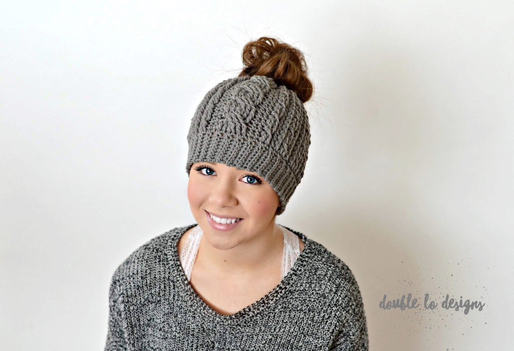 13c96b95ce901 Free Crochet Pattern - Crochet Cabled Messy Bun Hat (Adult Sizes) (video  tutorial