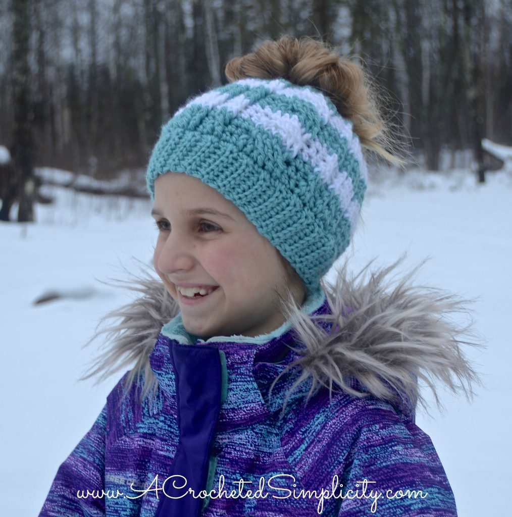 Free Crochet Pattern - Cabled Messy Bun Hat (video tutorial included) by A Crocheted Simplicity