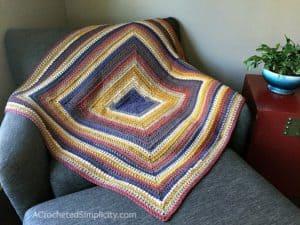 Centaur Mandala Afghan - Free Crochet Blanket Pattern by A Crocheted Simplicity#freecrochetpattern #freecrochetblanketpattern #crochetafghan #lionbrandmandalablanket #freecrochetlapghanpattern