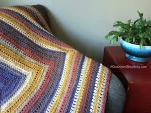 Centaur Afghan - Free Crochet Blanket Pattern by A Crocheted Simplicity#freecrochetpattern #freecrochetblanketpattern #crochetafghan #lionbrandmandalablanket #freecrochetlapghanpattern