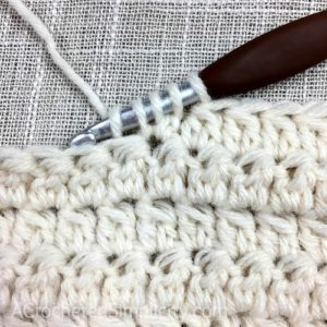 Learn to Crochet the 2 Double Crochet Cluster Stitch - Crochet Tutorial by A Crocheted Simplicity #crochetstitchtutorial #chainlesscrochetstitch #crochetclusterstitch #doublecrochetcluster #freecrochettutorial