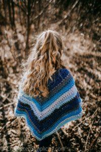 Free Crochet Pattern - Wasilla Poncho by A Crocheted Simplicity #freecrochetpattern #crochetponcho #crochet #girlsponcho #lionbrandmandala #crochetponchopattern