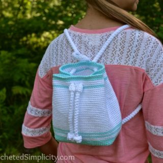 Free Crochet Pattern - Drawstring Mini-Backpack by A Crocheted Simpliciy #crochet #freecrochetpattern #crochetbackpack #minibackpack #drawstringbackpack