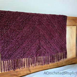 Aubergine Afghan - Free Crochet Blanket Pattern by A Crocheted Simplicity #freecrochetpattern #crochetblanketpattern #crochetafghanpattern #freecrochetblanketpattern #crochet #grannysquareblanket