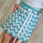 Crochet Skirt Pattern - Chasing Chevrons Girls Skirt by A Crocheted Simplicity #crochetskirt #crochetchevrons #chevrons #chevronskirt #crochetskirtpattern #girlsskirt #chevronskirt #crochetripple #girlsskirtpattern #handmadeskirt
