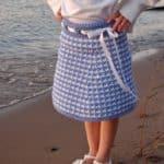 Crochet Skirt Pattern - Houndstooth Girls Skirt by A Crocheted Simplicity #crochetskirt #houndstooth #houndstoothcrochet #crochetskirtpattern #crochetforgirls #girlshoundstoothskirt #handmadeskirt