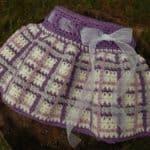 Crochet Skirt Pattern - Perfectly Plaid Girls Skirt by A Crocheted Simplicity #crochetskirt #crochetforgirls #pladiskirt #crochetplaid #crochetskirtpattern #handmadeskirt