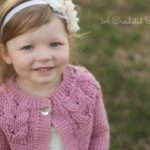 Girls Crochet Cabled Cardigan Pattern - Southern Charm Girls Cardigan by A Crocheted Simplicity #crochetcardigan #crochetforgirls #cabledcardigan #crochetcables #horseshoecables #crochetsweater #girlscardigan #cables #handmadecardigan