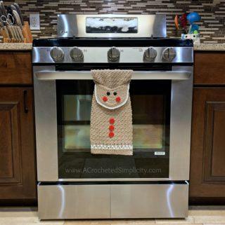 Free Crochet Pattern - Gingerbread Man Kitchen Towel by A Crocheted Simplicity #freecrochetpattern #crochetdishtowel #crochetteatowel #crochetkitchentowel #christmastowel #christmascrochet #gingerbreadman #crochetgingerbreadman