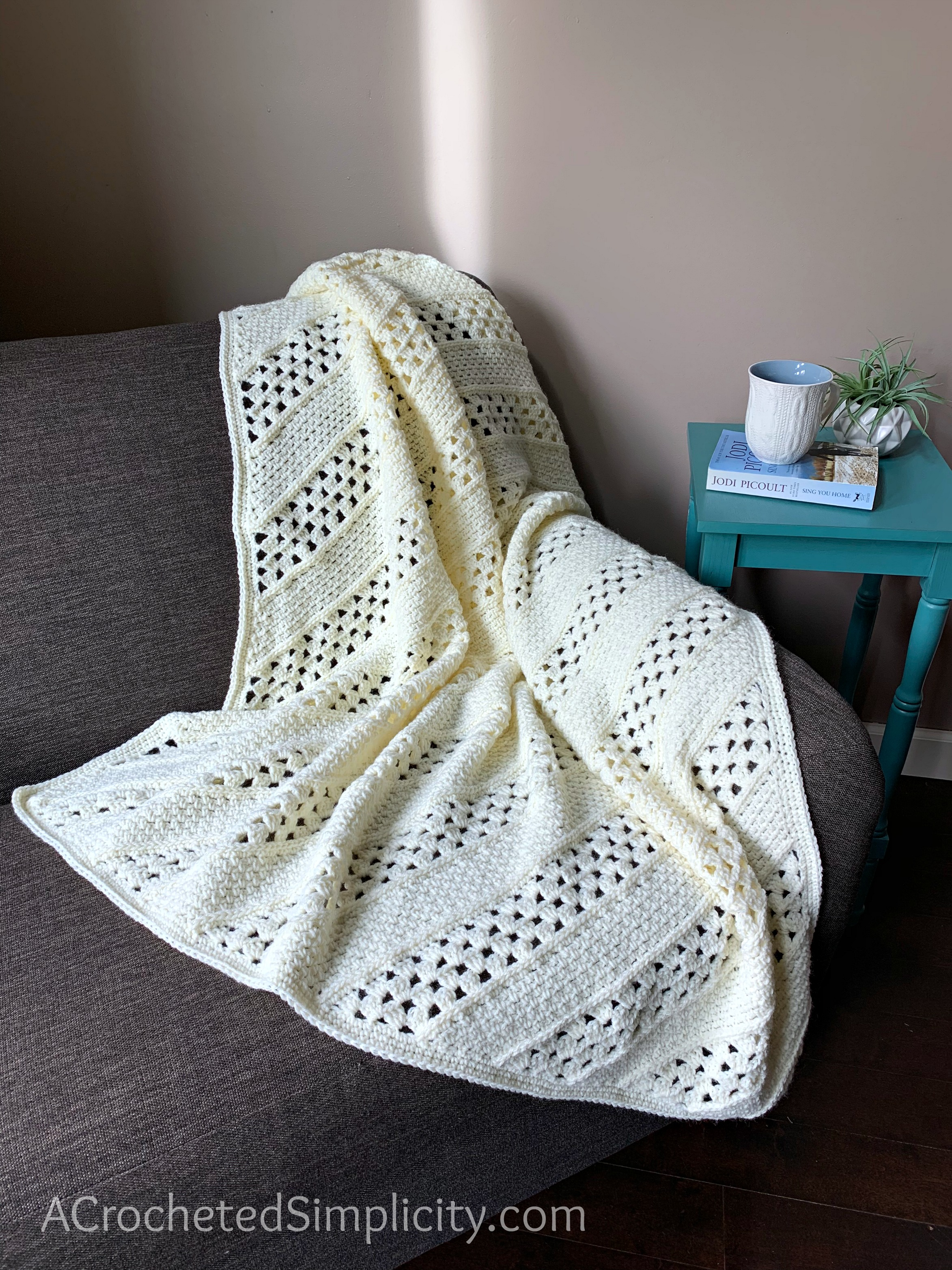 Free Crochet Blanket Pattern - On the Bias Square Afghan by A Crocheted Simplicity #crochetblanket #crochetafghan #freecrochetpattern #freecrochetblanketpattern #handmadeblanket #homemade #lionbrandwooleasecakes
