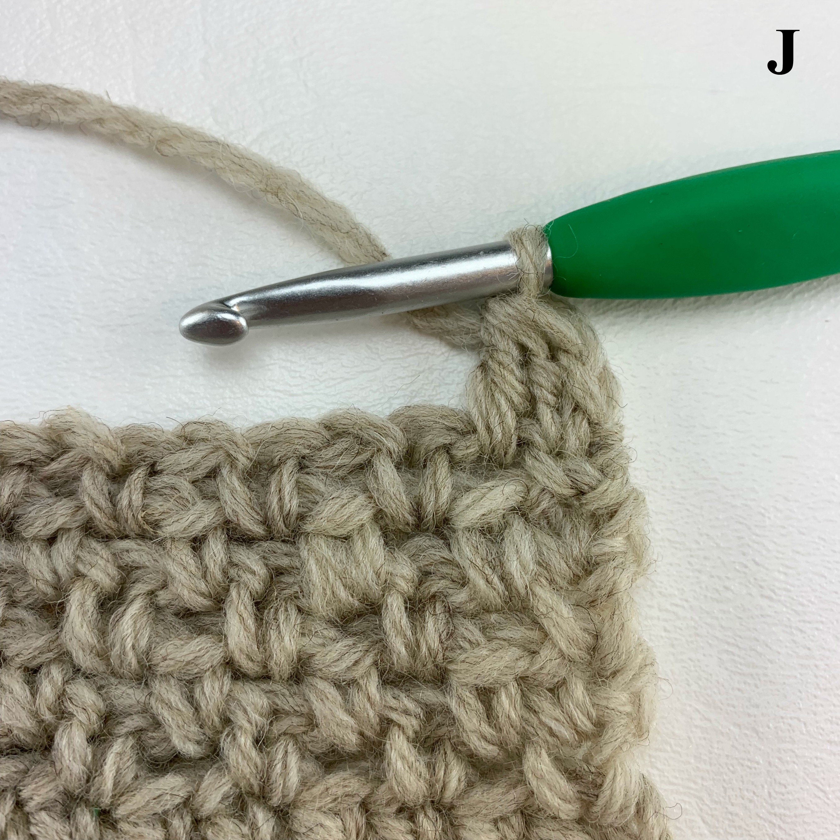 Learn to Crochet the Alternate Double Crochet Decrease, also know as a chainless double crochet - tutorial by A Crocheted Simplicity #crochetstitchtutorial #chainlessstitch #crochetstitchdecrease #alternatedoublecrochet