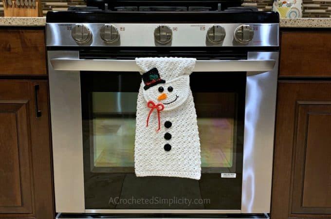 Free Crochet Pattern - Snowman Kitchen Towel by A Crocheted Simplicity #snowmantowel #freecrochetpattern #crochetdishtowel #crochetteatowel #crochetkitchentowel #christmastowel #christmascrochet #snowman #crochetsnowmman