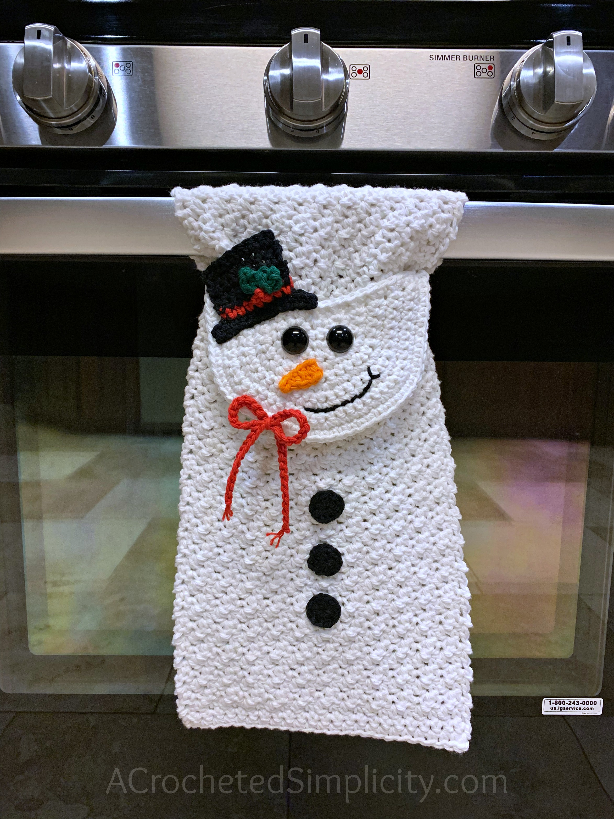 Free Crochet Pattern - Snowman Kitchen Towel by A Crocheted Simplicity #snowmantowel #freecrochetpattern #crochetdishtowel #crochetteatowel #crochetkitchentowel #christmastowel #christmascrochet #snowman #crochetsnowmman