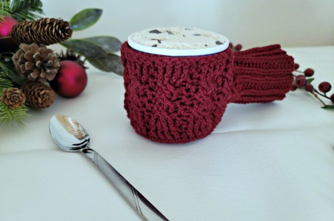 Free Crochet Drink Mitt Pattern - Cabled Sweater Ice Cream Cozy & Drink Mitt by A Crocheted Simplicity #freecrochetpattern #cozyholidaycal #crozydrinkmitt #crochetdrinkmittpattern #crochetcables
